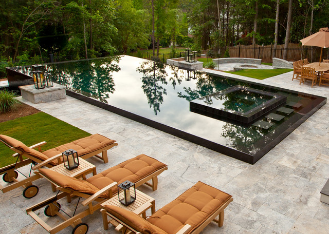 Example Of A Large Trendy Backyard Stone And Rectangular Infinity Hot Tub Design In Atlanta