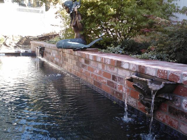 Brick Beauty traditional-pool