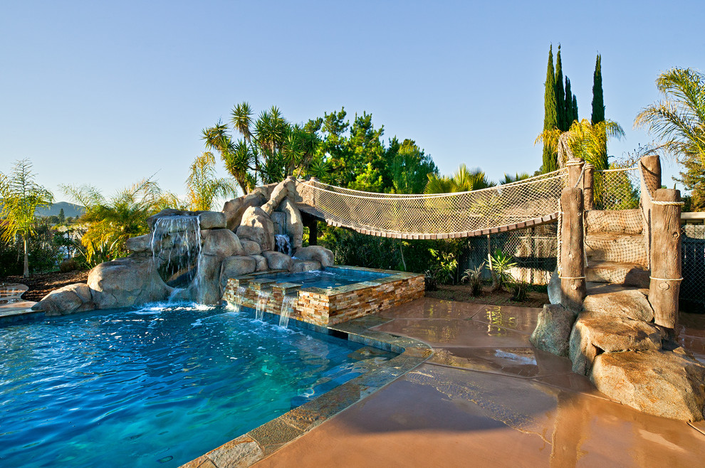 Mid-sized island style backyard rectangular and concrete lap water slide photo in San Diego