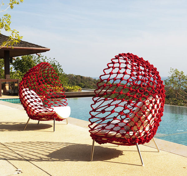 By the pool with Kenneth Cobonpues Dragnet Lounge Chairs modern pool
