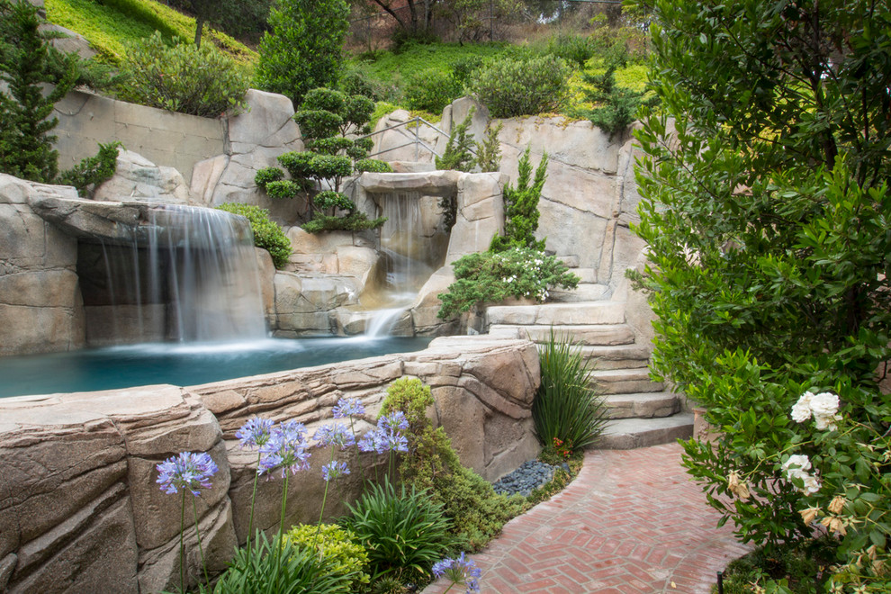 Inspiration for an eclectic natural pool fountain remodel in Austin