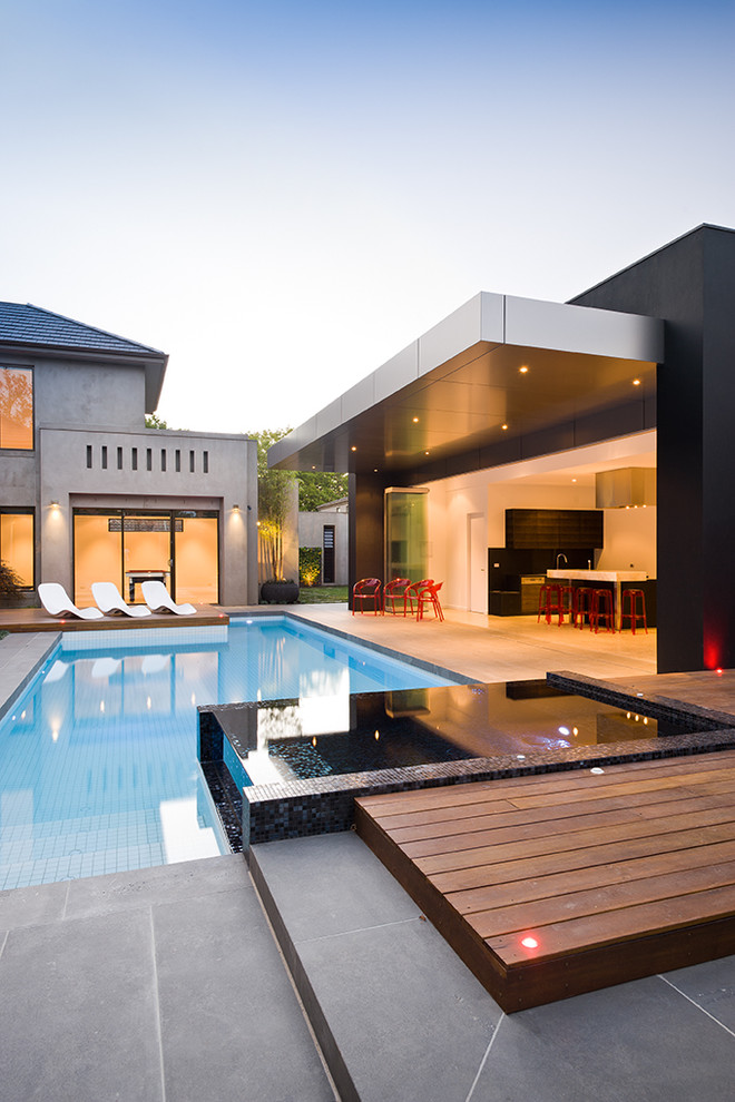 Inspiration for a contemporary custom-shaped pool remodel in Melbourne