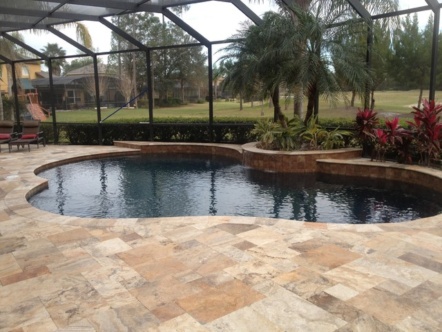 Cappadocia scabos travertine pavers tropical pool for Pool design tampa