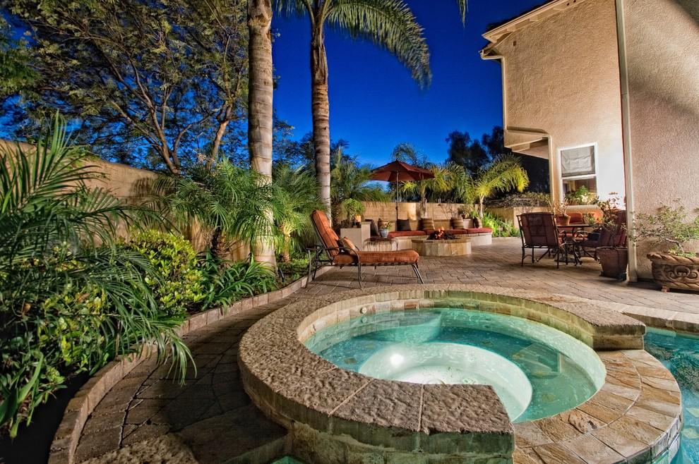Island style pool photo in San Diego