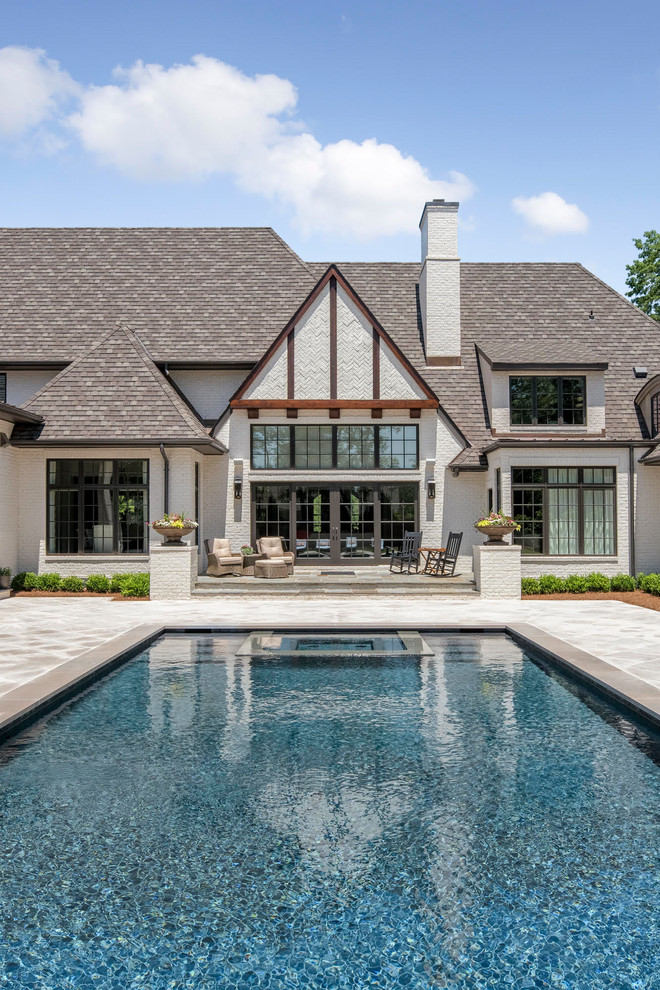 Inspiration for a large country backyard tile and rectangular hot tub remodel in Charlotte