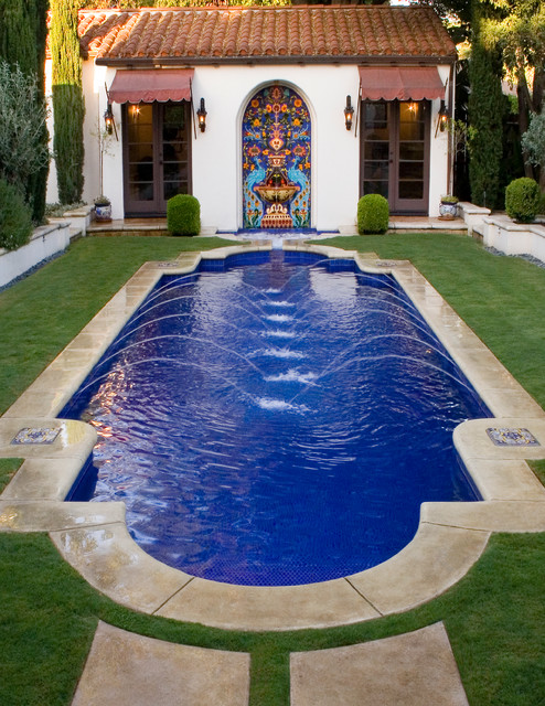 Example Of A Tuscan Concrete Paver And Custom Shaped Pool Design In Los  Angeles