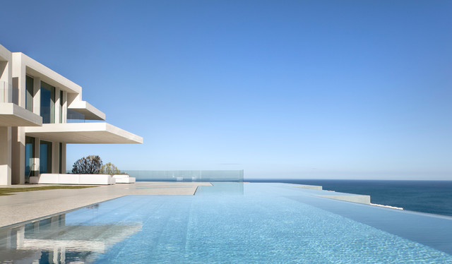 Inspiration for a huge contemporary backyard concrete and custom-shaped infinity pool remodel in Alicante-Costa Blanca