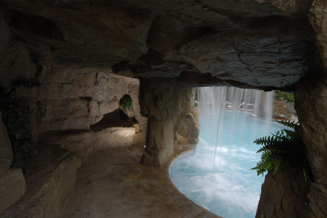 cave grotto enclosed slide with waterfalls tropical pool