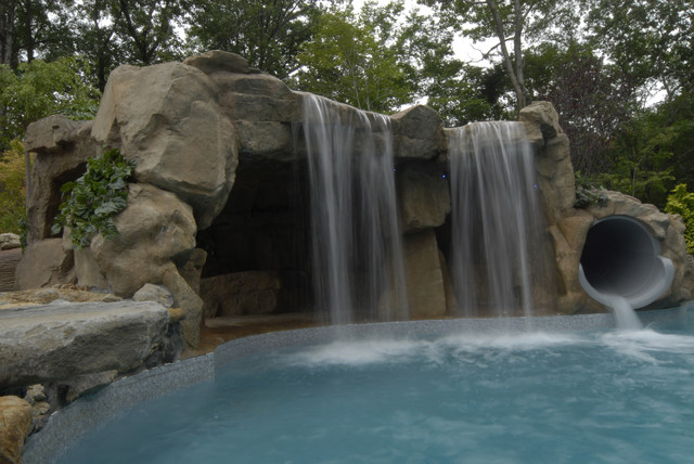 Cave Grotto Enclosed Slide With Waterfalls Tropical Swimming Pool And