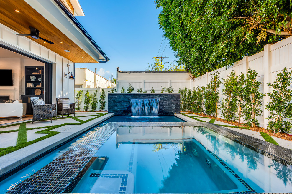 Inspiration for a transitional backyard custom-shaped lap pool remodel in Los Angeles