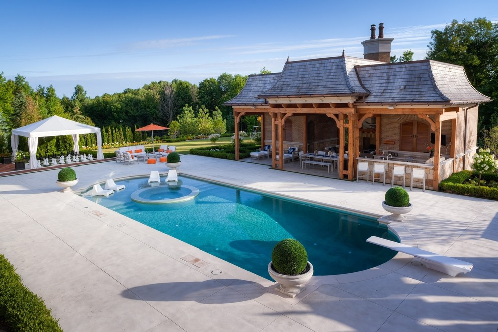 Inspiration for a huge contemporary backyard stamped concrete and custom-shaped pool house remodel in Toronto