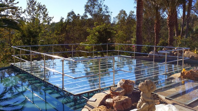 Clear acrylic pool cover over swimming pool for wedding for Bauhaus pool