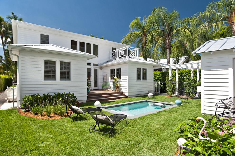 Pool - small coastal backyard rectangular pool idea in Miami