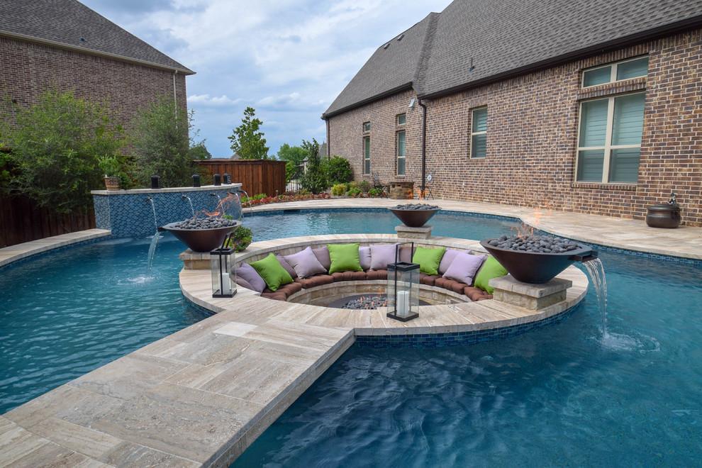 Pool fountain - contemporary tile and custom-shaped pool fountain idea in Dallas