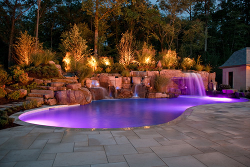 Mediterranean style swimming pool with purple LED lights