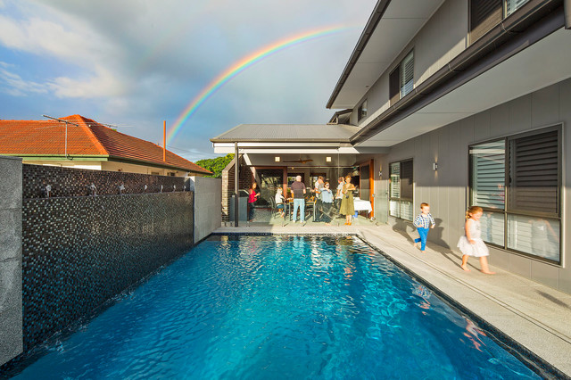 Mid-sized trendy backyard tile and rectangular natural pool fountain photo in Brisbane
