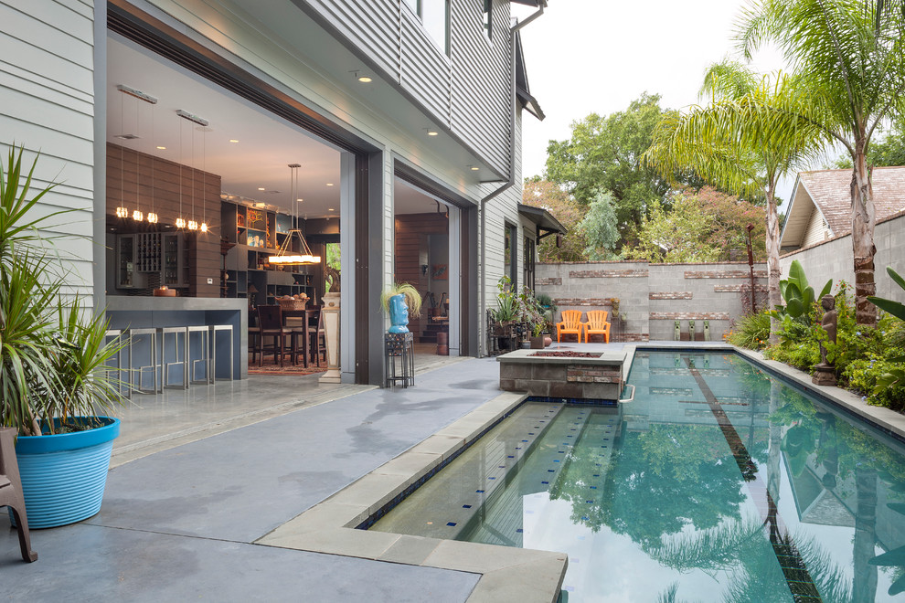 Inspiration for a contemporary courtyard lap pool remodel in Houston