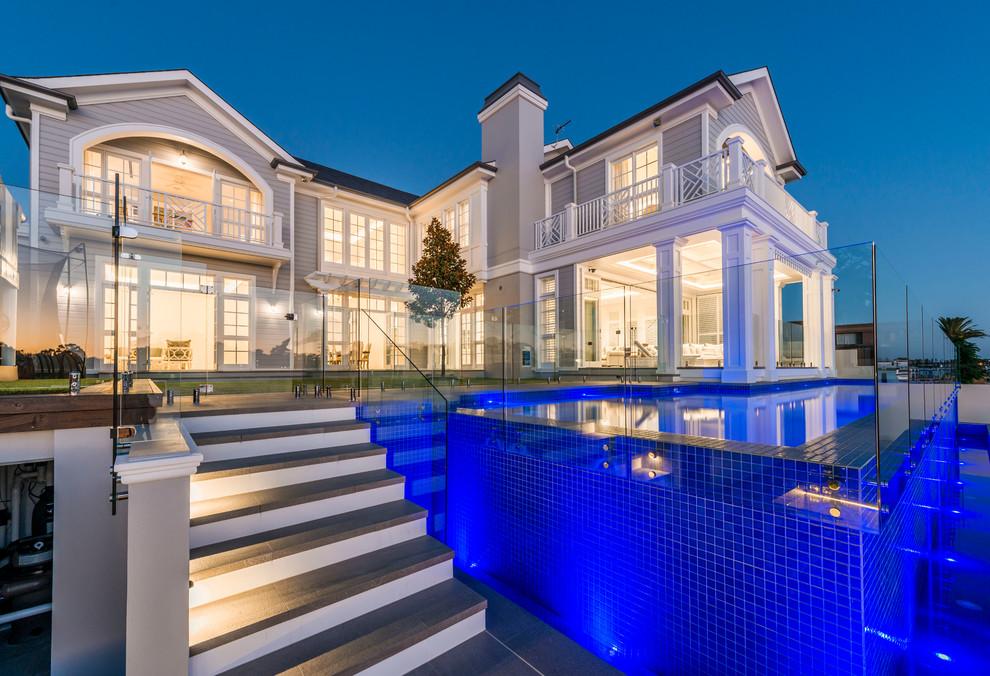 Pool - contemporary backyard l-shaped aboveground pool idea in Gold Coast - Tweed