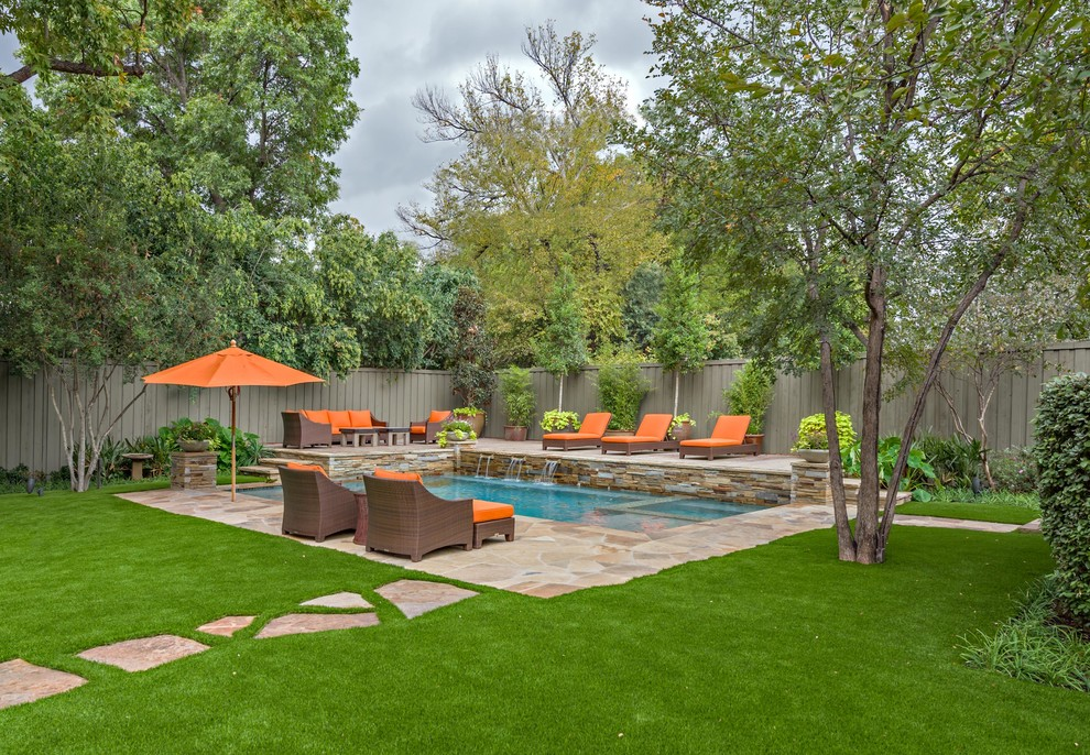 Example of a trendy pool design in Dallas with decking