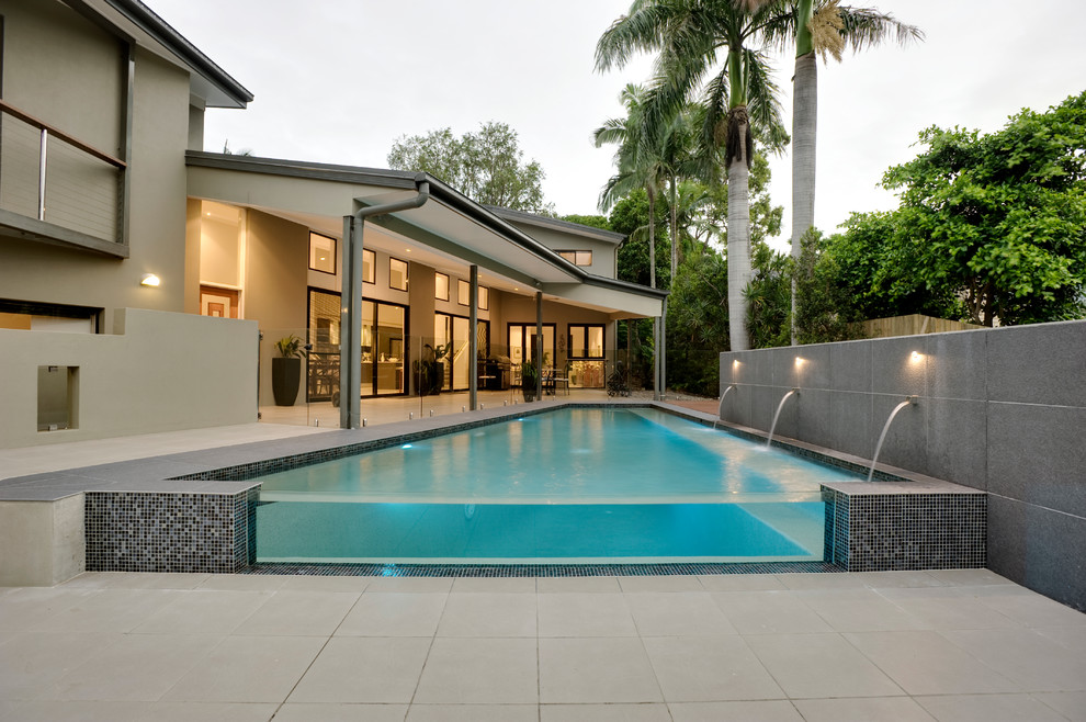 Inspiration for a contemporary concrete paver and rectangular pool remodel in Brisbane