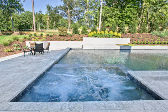 Contemporary Style Pool With Silver Travertine Deck And
