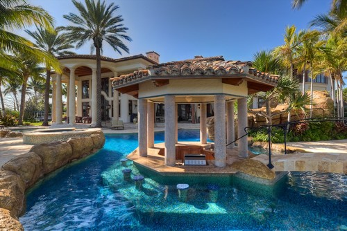 7 luxury swimming pools with swim up bars for Pool design with swim up bar
