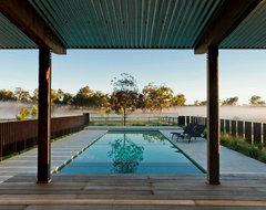 Corten pool fence and pavilion farmhouse-landscape