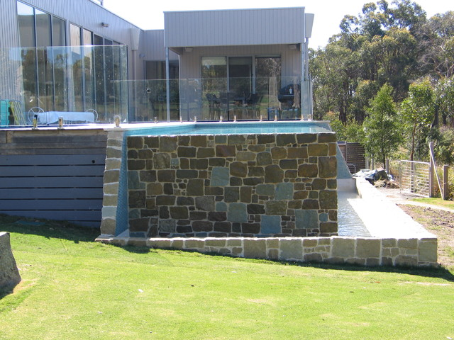country style infinity pool contemporary-pool