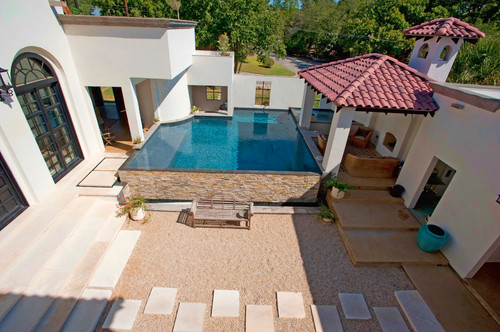 This above ground pool is unique as it is bricked into this villa style home. This is an atypical example of an above ground pool, but is is an interesting idea.