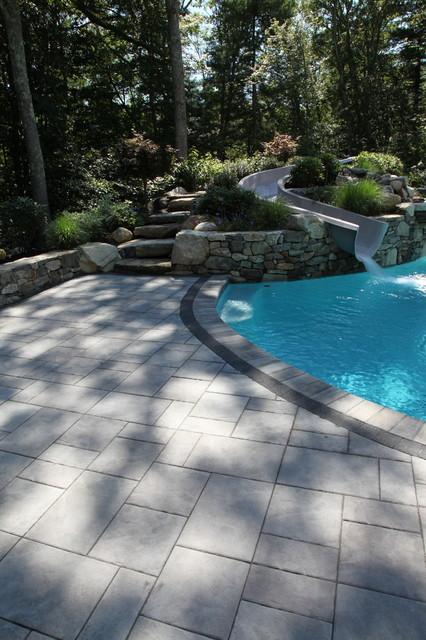 Custom swimming pool water slide pool boston by for Custom pool water slides