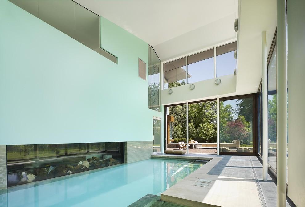 Pool - huge modern indoor stone and rectangular lap pool idea in Toronto