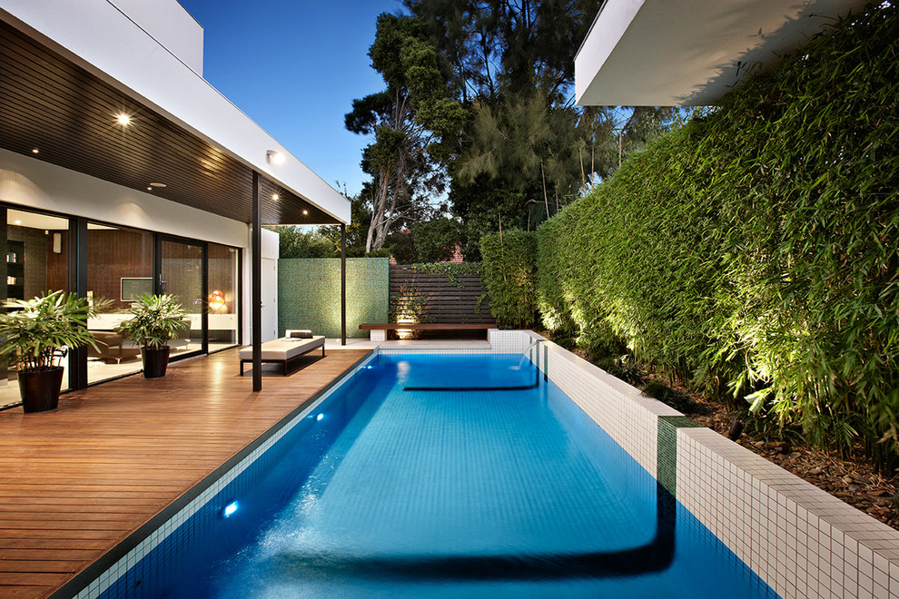 Trendy pool photo in Melbourne with decking