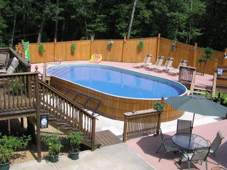 Pool - mediterranean backyard concrete aboveground pool idea in New York