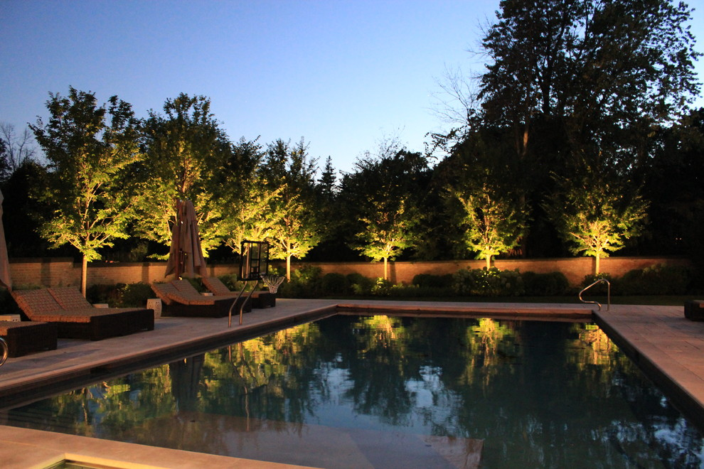 Inspiration for a large timeless backyard stone and rectangular pool remodel in Chicago