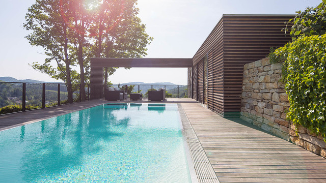 Fesselnd Inspiration For A Large Modern Backyard Rectangular Pool Remodel In Other  With Decking