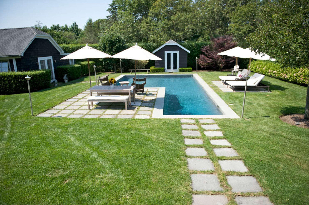 Pool - mid-sized contemporary backyard aboveground pool idea in New York