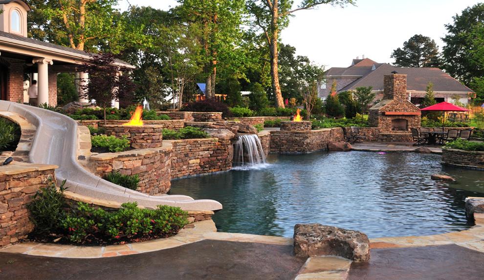 Water slide - traditional backyard custom-shaped water slide idea in Nashville