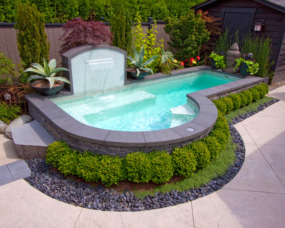 Pool - eclectic custom-shaped pool idea in Vancouver