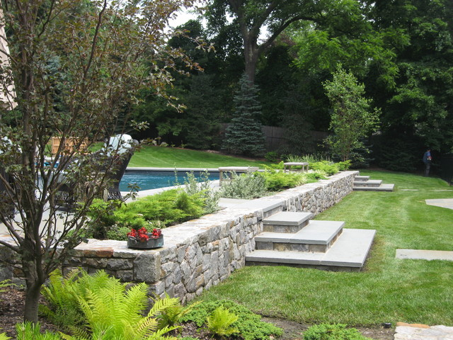 Edgewater design llc for Pool design sloped yard