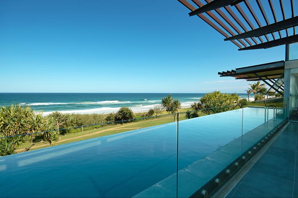Pool - large coastal rectangular infinity pool idea in Brisbane