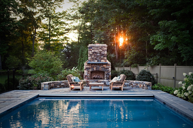 A modern inground pool and entertaining area with an outdoor gas fireplace for cooler nights