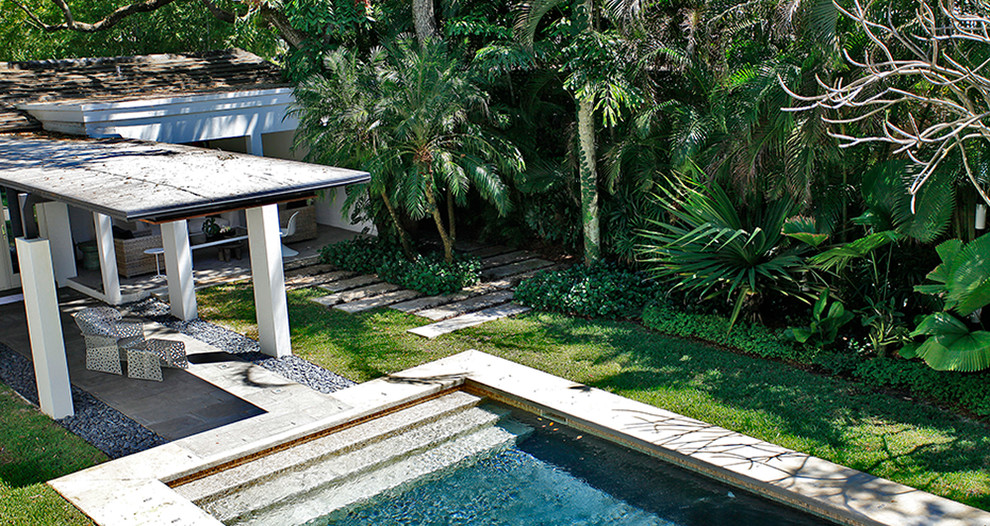 Pool - mid-sized modern backyard concrete paver and rectangular pool idea in Miami