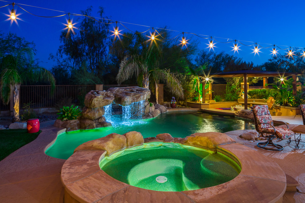 Inspiration for a southwestern backyard tile and custom-shaped lap hot tub remodel in Phoenix