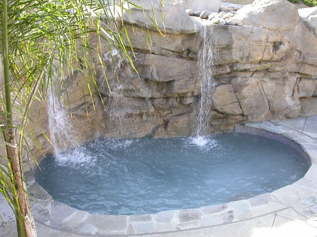 Faux rock waterfall & retaining wall tropical-pool
