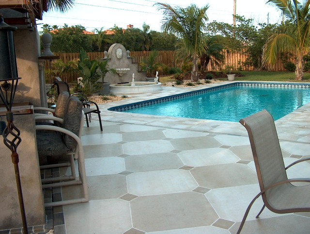 Flagstone and tile pool deck mediterranean pool for Pool design orlando florida