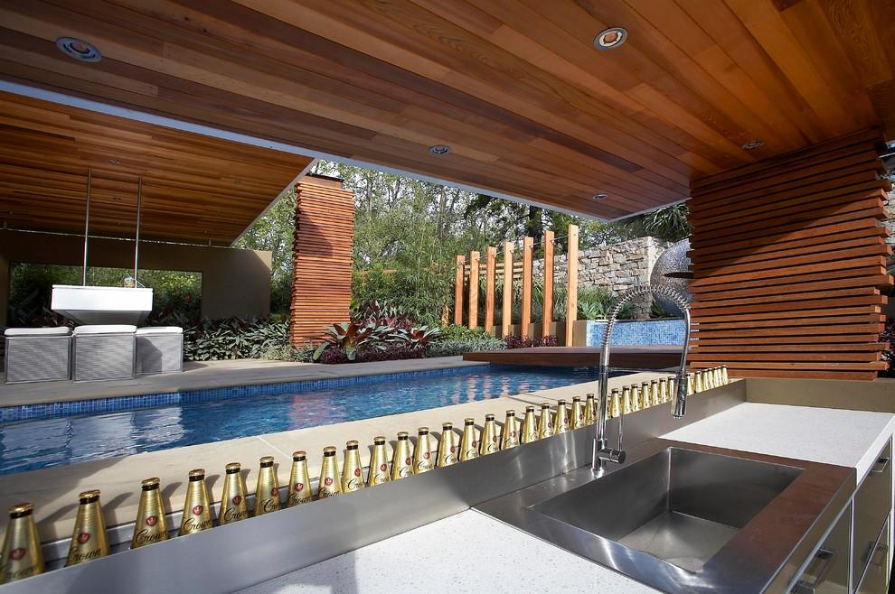 Trendy rectangular lap pool photo in Melbourne