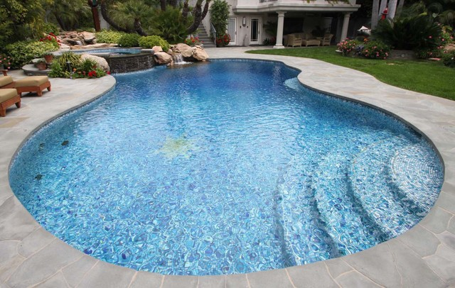 Free-Form Radius Bisazza Glass Mosaic Pool and Natural Stone Overflow Spa traditional-pool