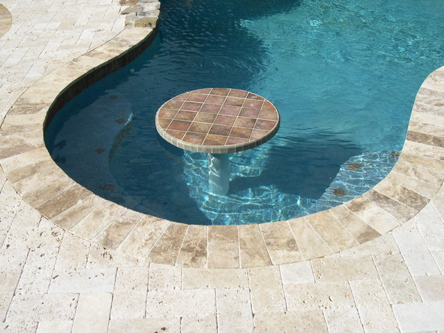 free form swimming pool with table bench seating trotta tropical pool miami by pool