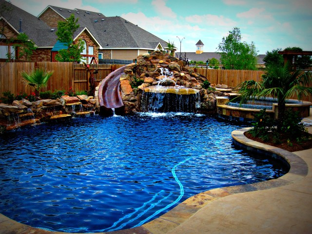 Backyard patio ideas flagstone - Freeform Pool Designs