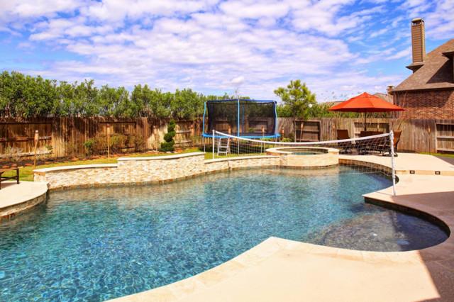 Freeform pool katy texas contemporary pool houston for Pool design katy tx